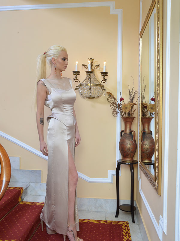 danijela bozic model with tatoo in golden dress